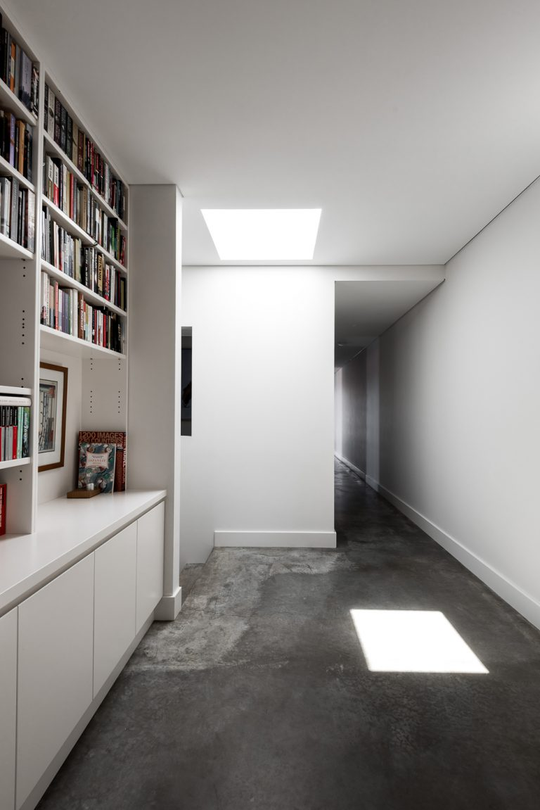 18-hallway-bookcase-urban-house-western-suburbs-architect-Robeson-Architects
