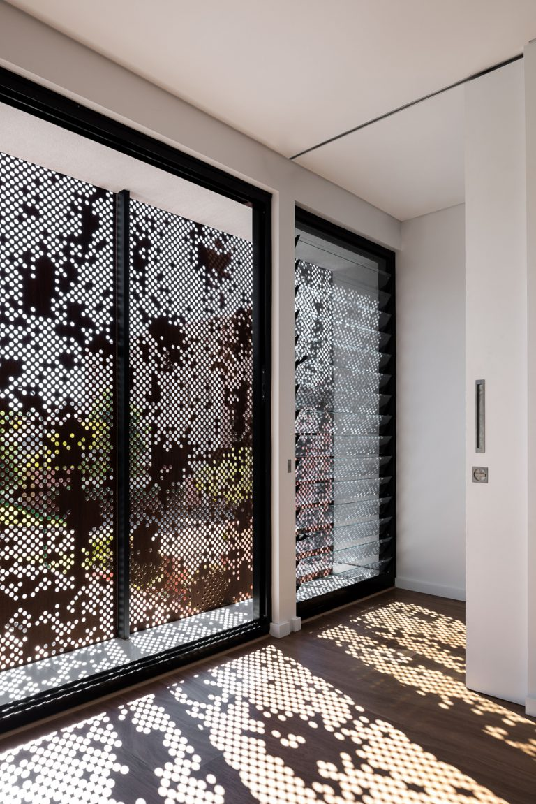 4_interior-view-custom-corten-steel-panels-designed-by-Cottesloe-Architect-Robeson-Architects.jpg