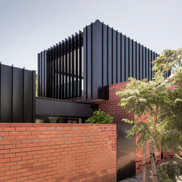 Exterior of brick wall and aluminium cladding of King George Street property designed by Perth Residential architect Simone Robeson of Robeson Architects