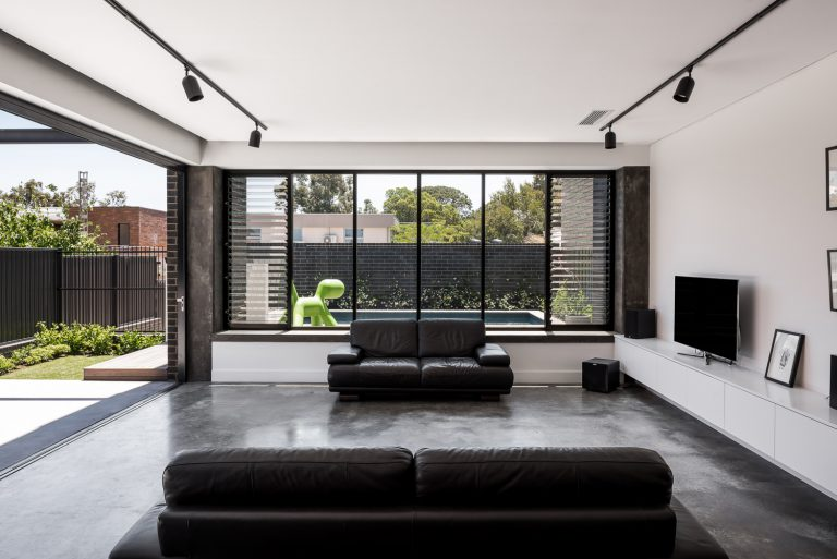 11-lounge-room-galley-kitchen-and-artwork-urban-house-western-suburbs-architect-Robeson-Architects