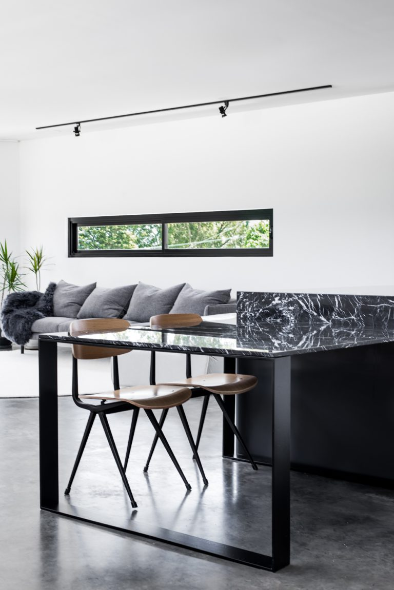 7-Triangle-House-nero-marquina-dining-table-Mount-Lawley-architect-by-Robeson-Architects